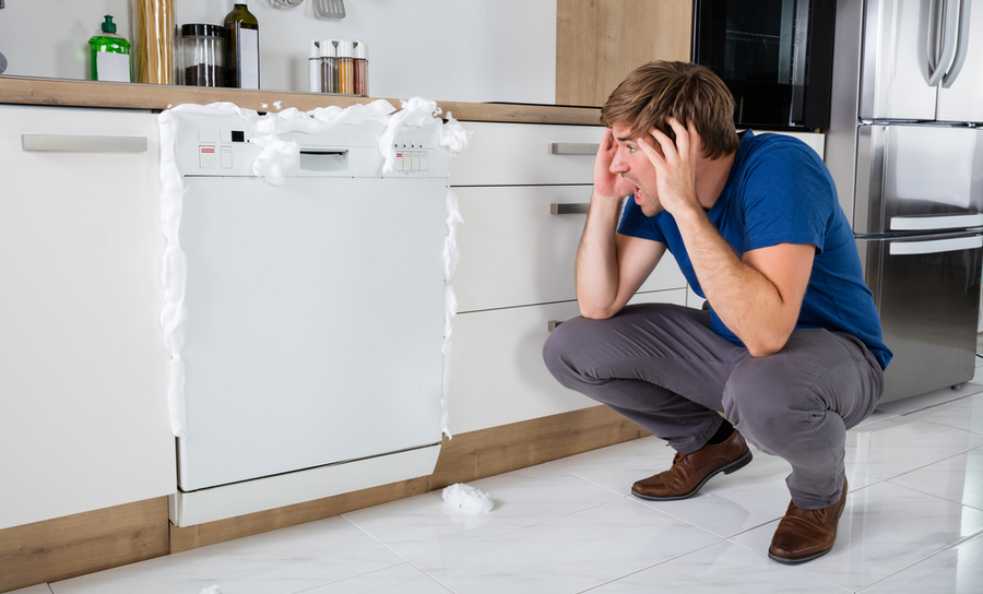 Picture of an upset man because his dishwasher has too much power