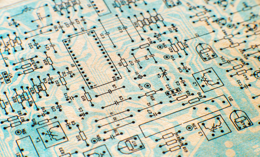 Old circuit schematic with blue routing print overlaid