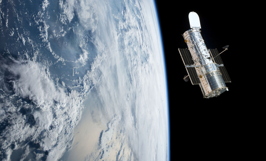 Hubble telescope over the Earth in space