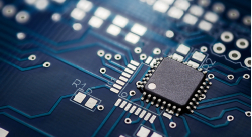 Chip and microcontroller on a blue circuit board
