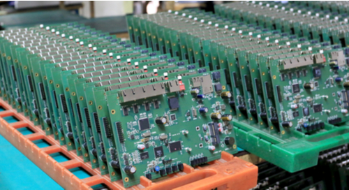 Printed circuit boards aligned in a fabrication facility