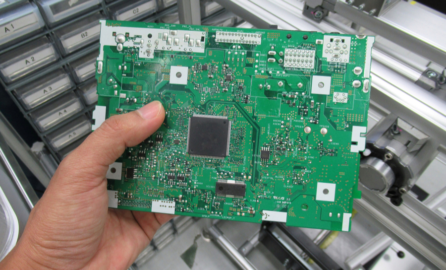 Holding a printed circuit board in a facility