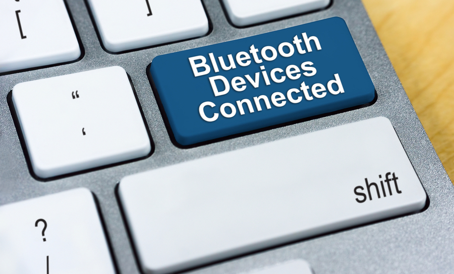 Keyboard that has bluetooth devices connected on a key
