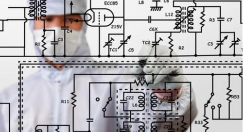 Engineer writing a schematic on a board
