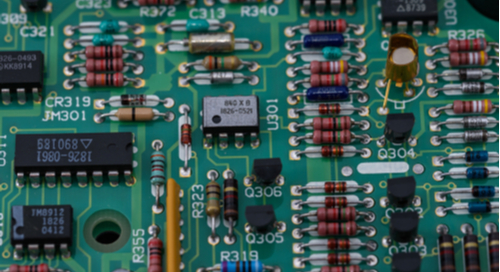 Pristinely laid out components on a green printed circuit board