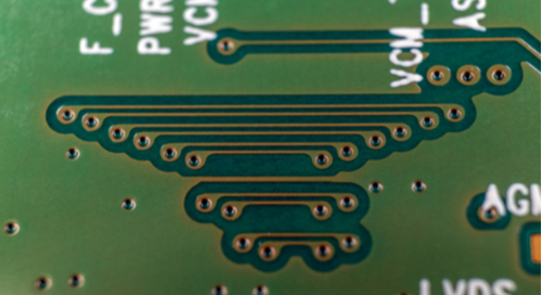 Conductive traces through vias on a green printed circuit board