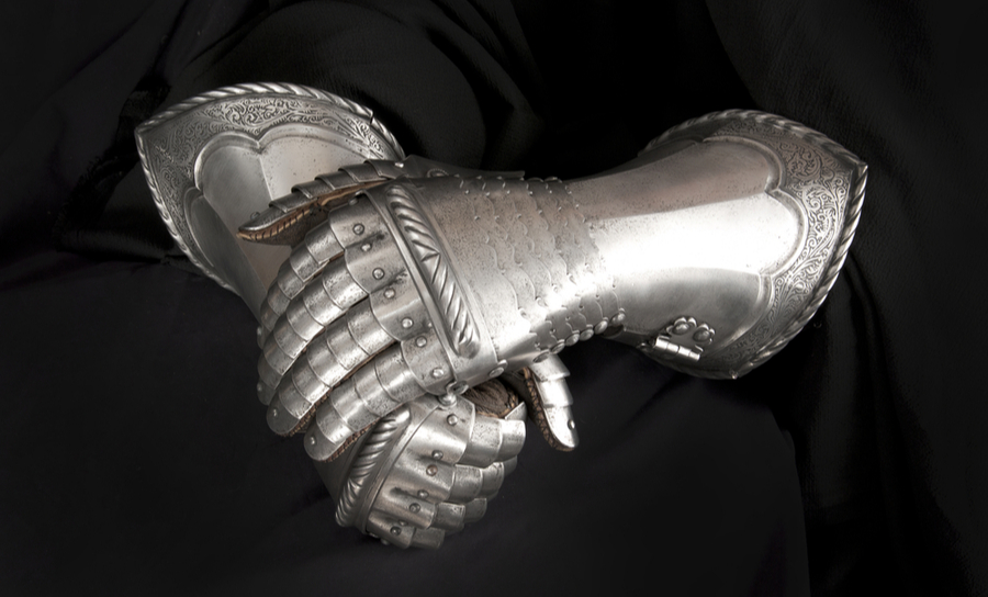 Picture of a pair of metallic gloves worn by a knight