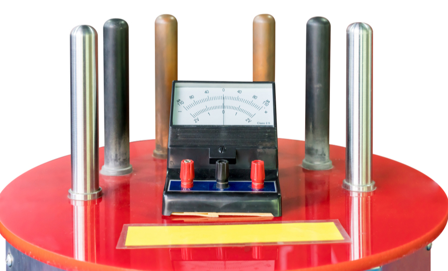 Multimeter and metal rods on red platform