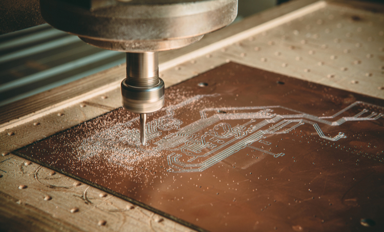 A circuit board being milled on a CNC machine