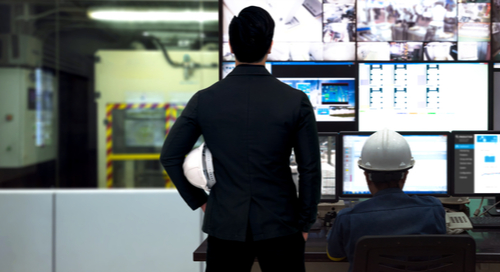 Two engineers looking at screens for industry 4.0