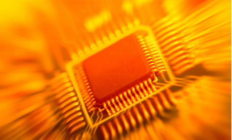 Picture of a computer chip colored in orange to show its heat