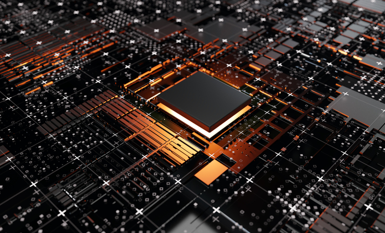 A microcontroller in the middle of a gridlike printed circuit board