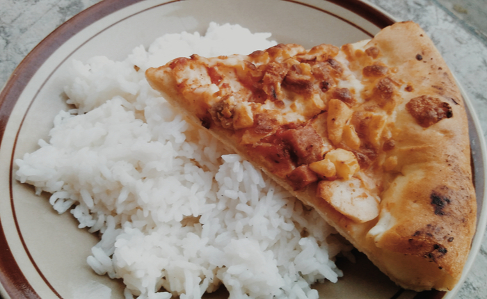 Picture of rice and pizza on a plate
