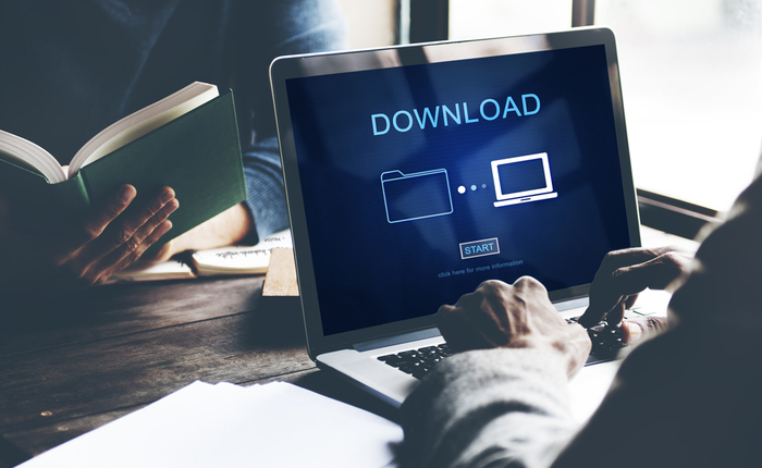 Computer screen with image of folder and monitor saying download