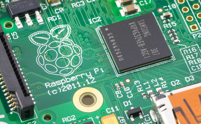 Zoomed in view of a Raspberry Pi printed circuit board (PCB) with Samsung chipset