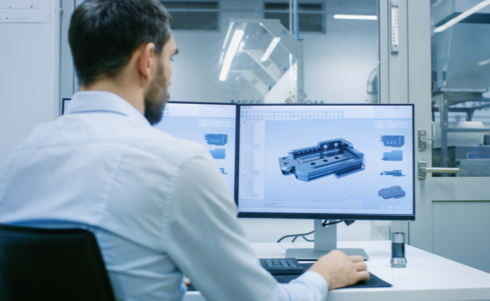 Engineer working on a 3D product rendering in CAD program