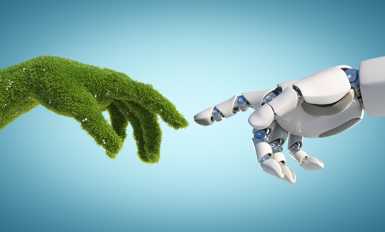 A hand made of plants touching a robotic hand