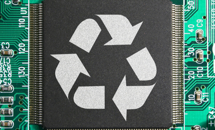 Symbol for recycling on a PCB backdrop.