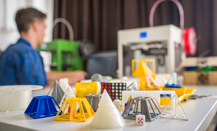a table with many 3D printed prototypes