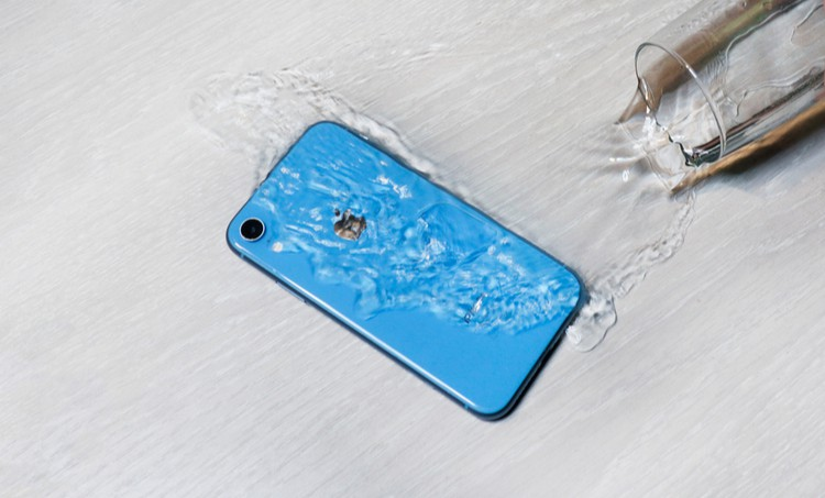 Water being poured on an Apple iPhone