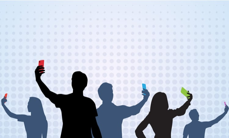 Illustration of silhouettes of people taking selfies