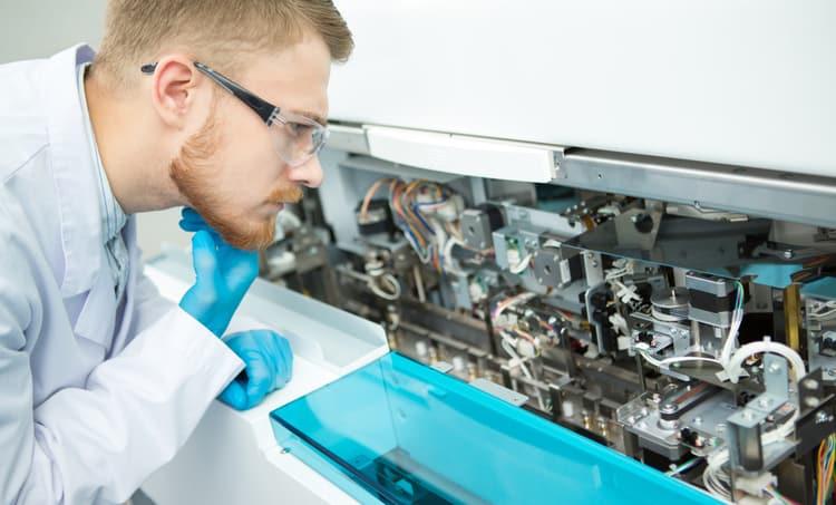 Engineer examining machinery using rigid-flex PCBs