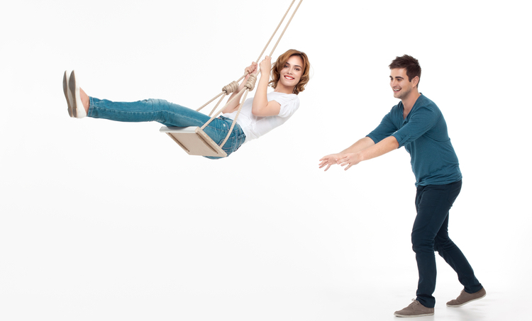 Woman being pushed on a swing