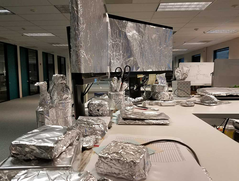 Office materials wrapped in aluminum foil