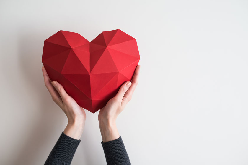 hands holding polygonal heart