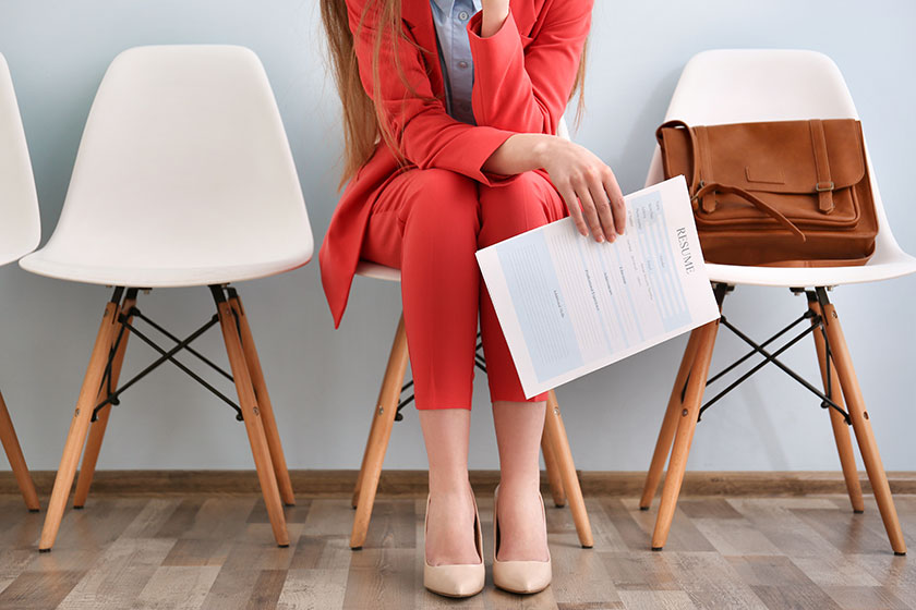 Woman sitting with resume in hand
