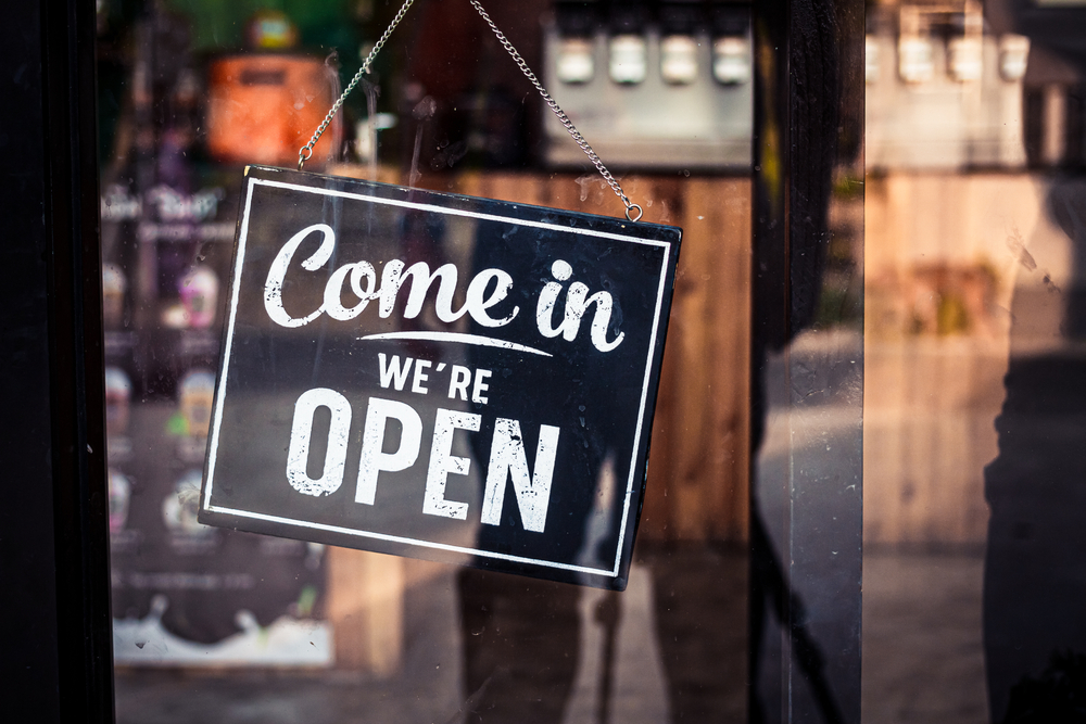 Come in we're open sign hanging on business door