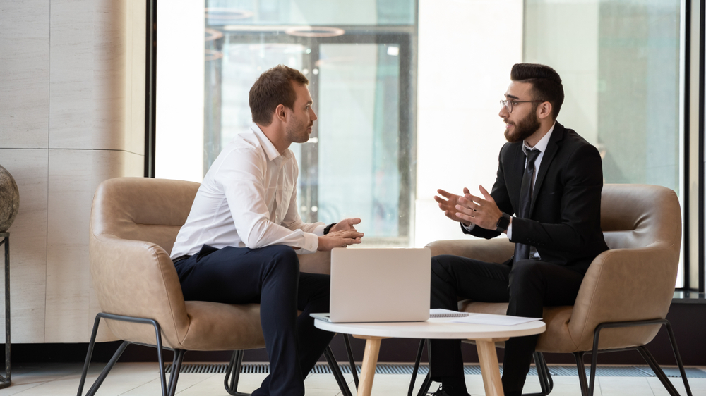 recruiting manager interviewing a man practicing talent acquisition while managing his digital strategy