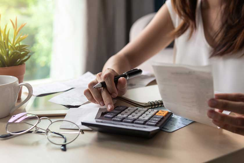 business leader running calculations after using an accounting staffing firm