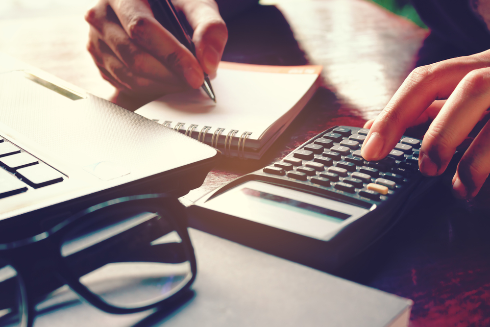 accountant putting in practice what was learned in a budget cycle mastering course