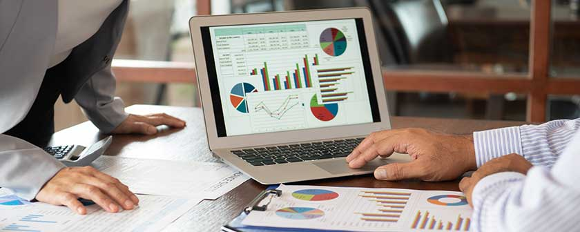 cfo and controller analyzing financial metrics