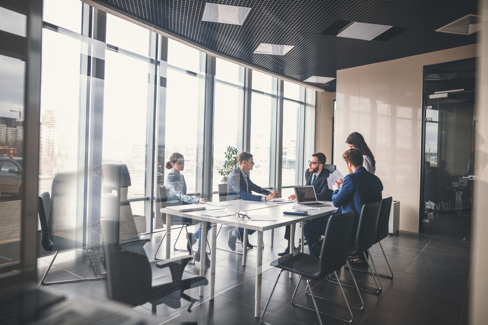 CFO in meeting with executive vice president and top CFO thought leaders