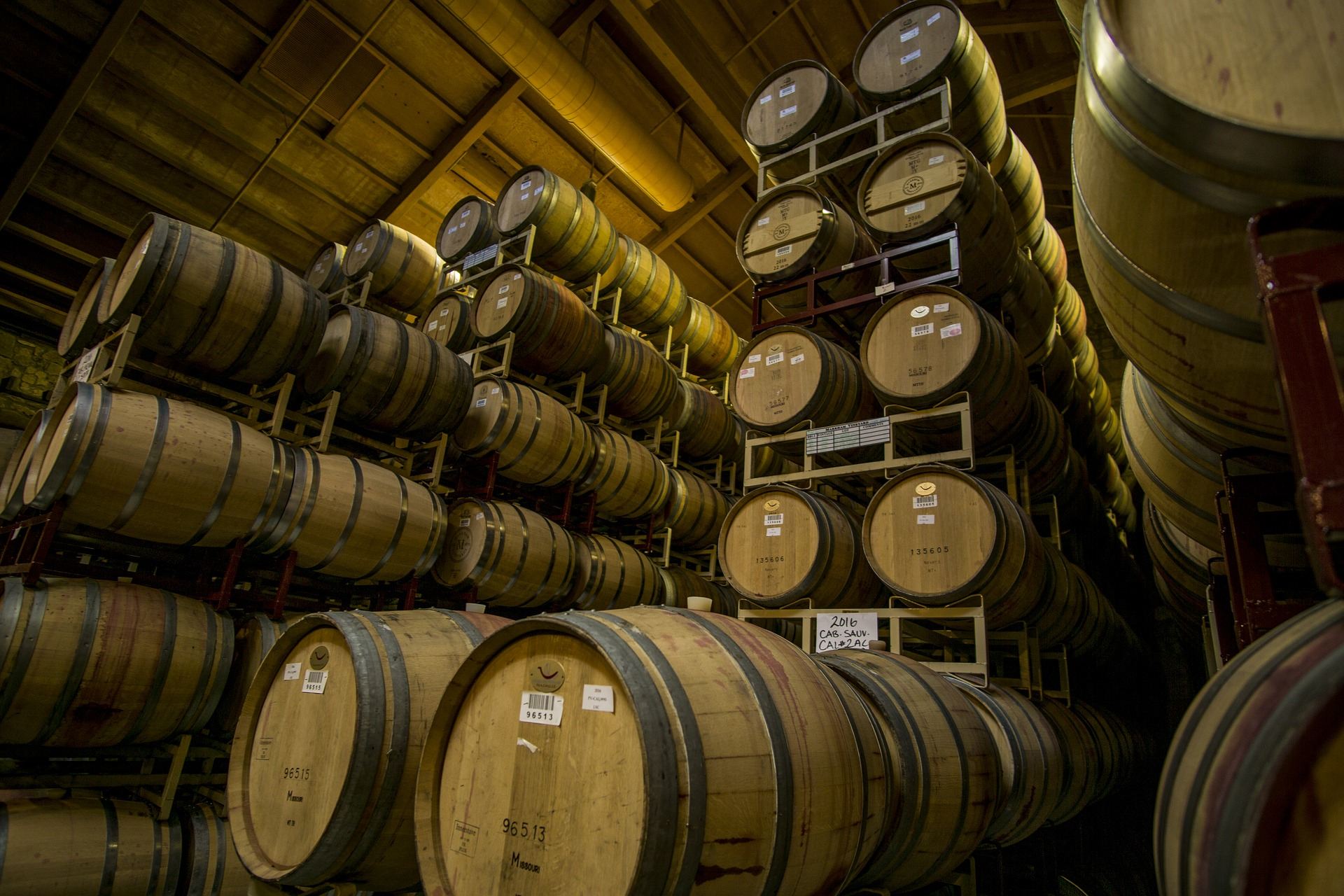 Stacks of barrels that are two barrels wide and five barrels high. - TAB Bank