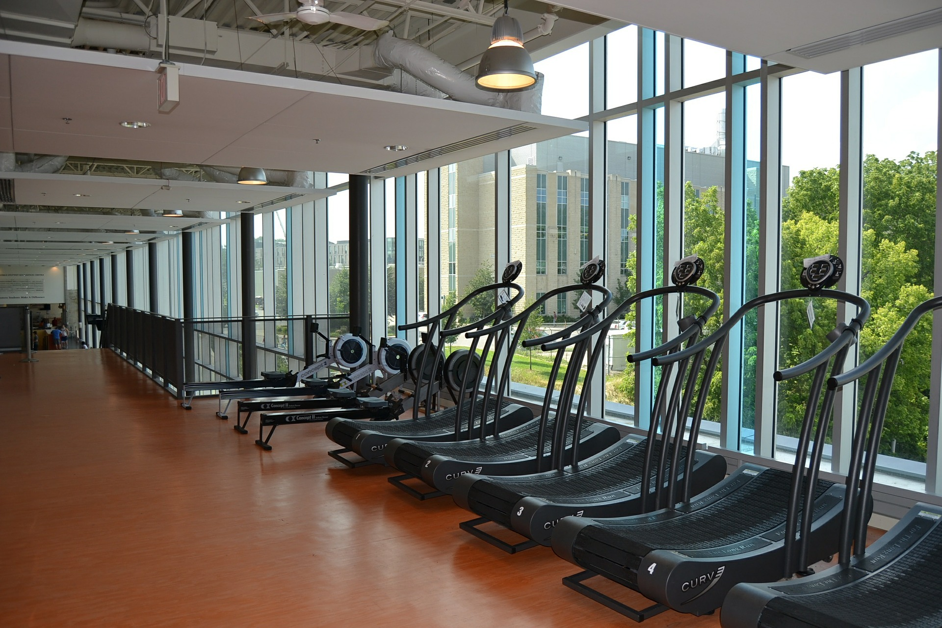 Fitness center with treadmills against a window - TAB Bank