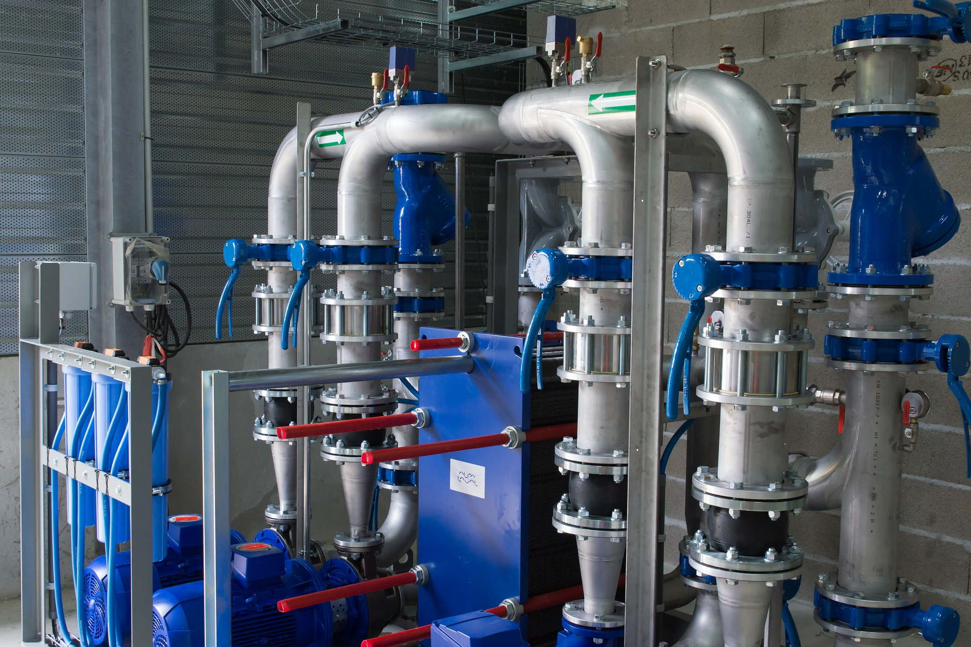 Image of pipes that are used to control fluid flows in a commercial setting - TAB Bank