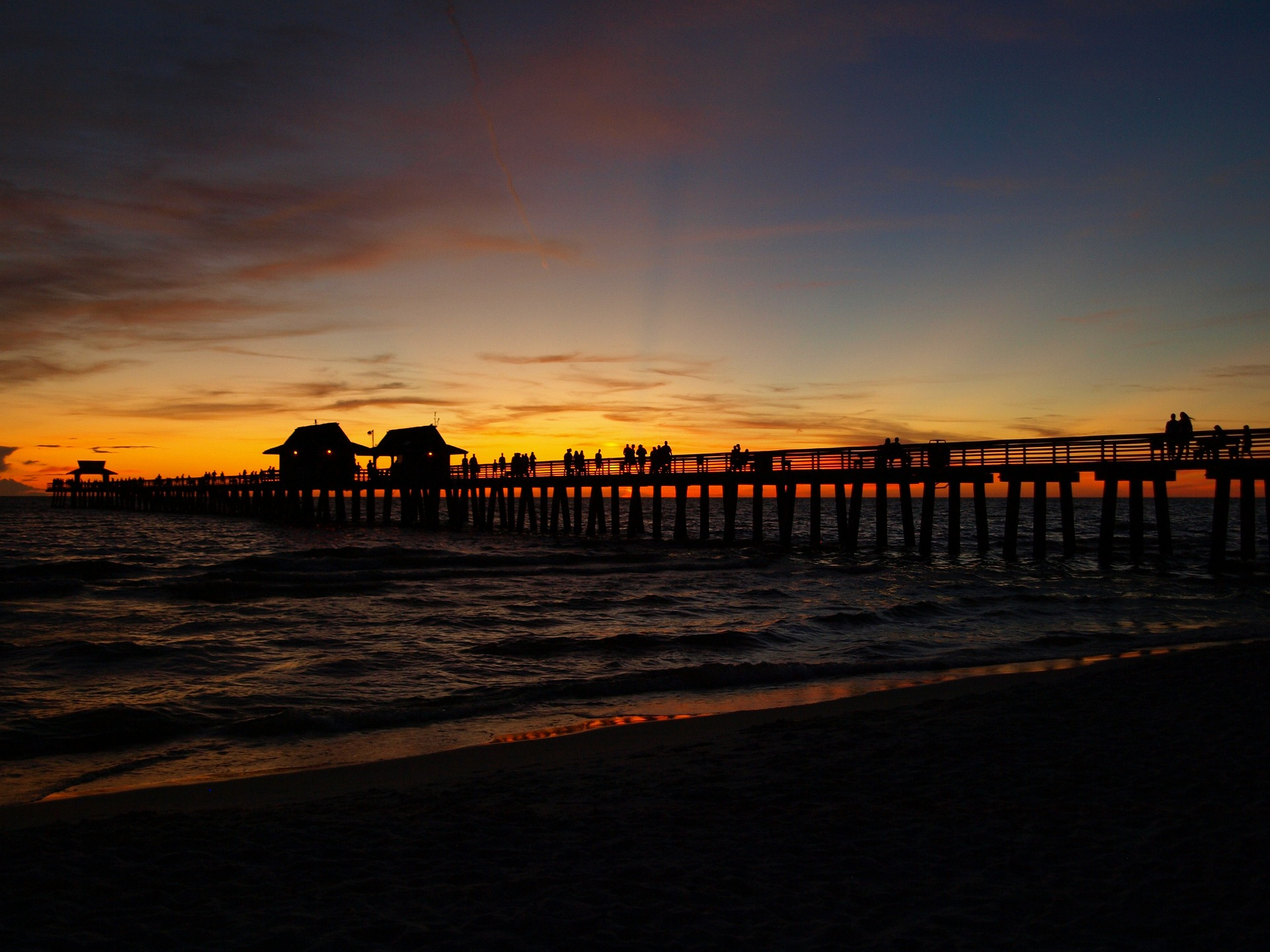 Image of sunset over the pier in Naples, FL | TAB Bank