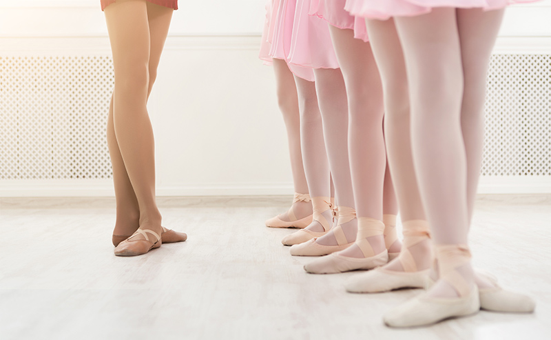 Image of ballet stuendent's legs with their instructor out in front of them | TAB Bank