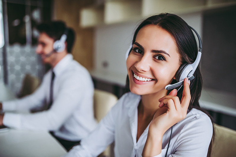 Image of happy lady and man in a call center | TAB Bank