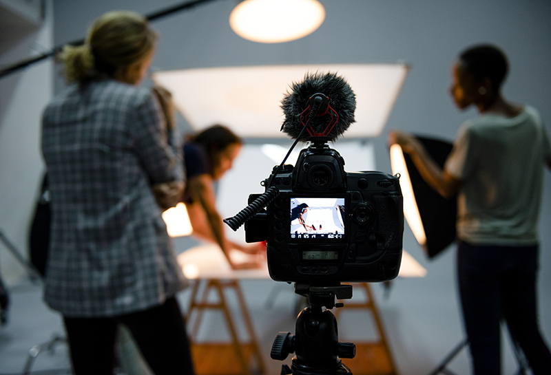 Image of a crew working on a product photo shoot in the studio with cameras and lights | TAB Bank