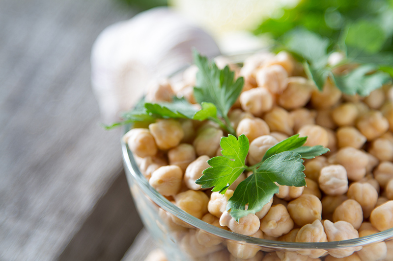 Image of a bowl of Garbanzo beans with some green garnish | TAB Bank