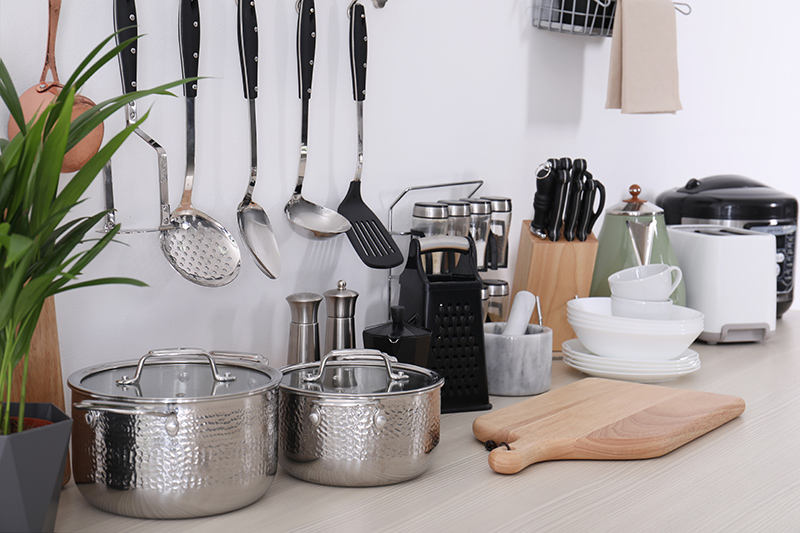 Image of a myriad of kitchen utensils on a kitchen counter | TAB Bank