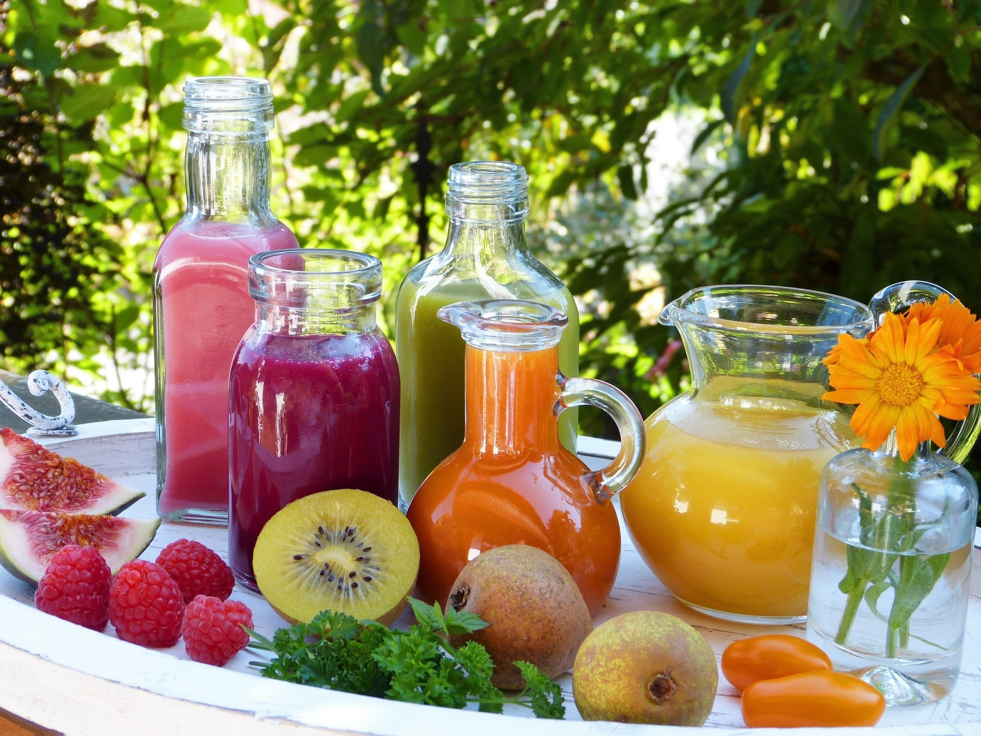 Image of fruits and vegetables and juice containers full of different juices | TAB Bank