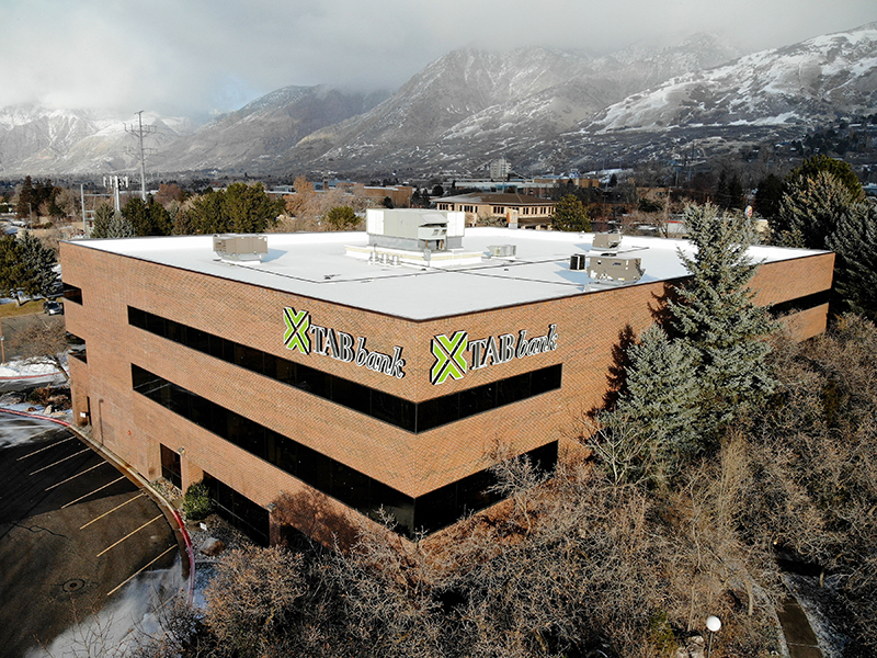 Image of the outside of TAB Bank with the mountains of the Wasatch Front in the background