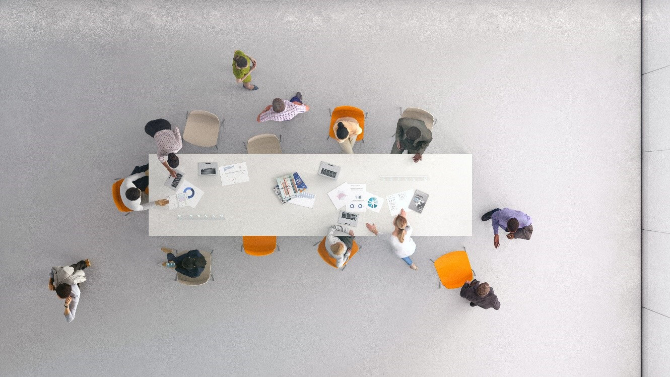people working around a long table