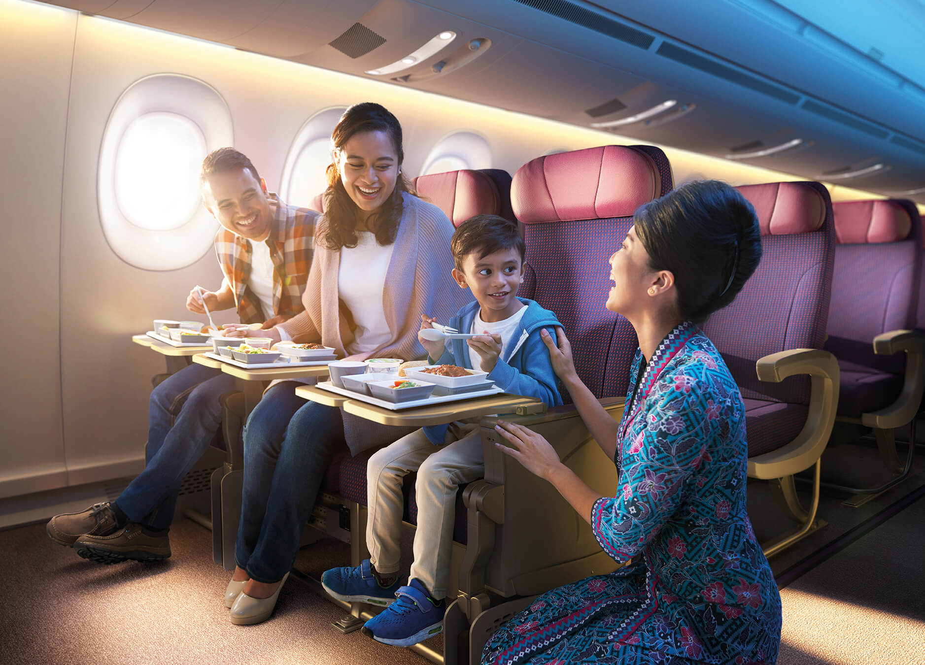 Family having a meal on an airplane