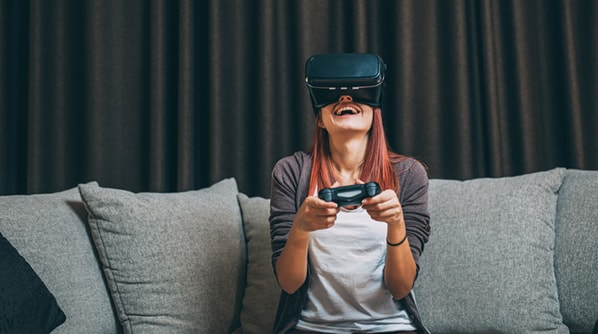 Woman using Virtual Reality for gaming